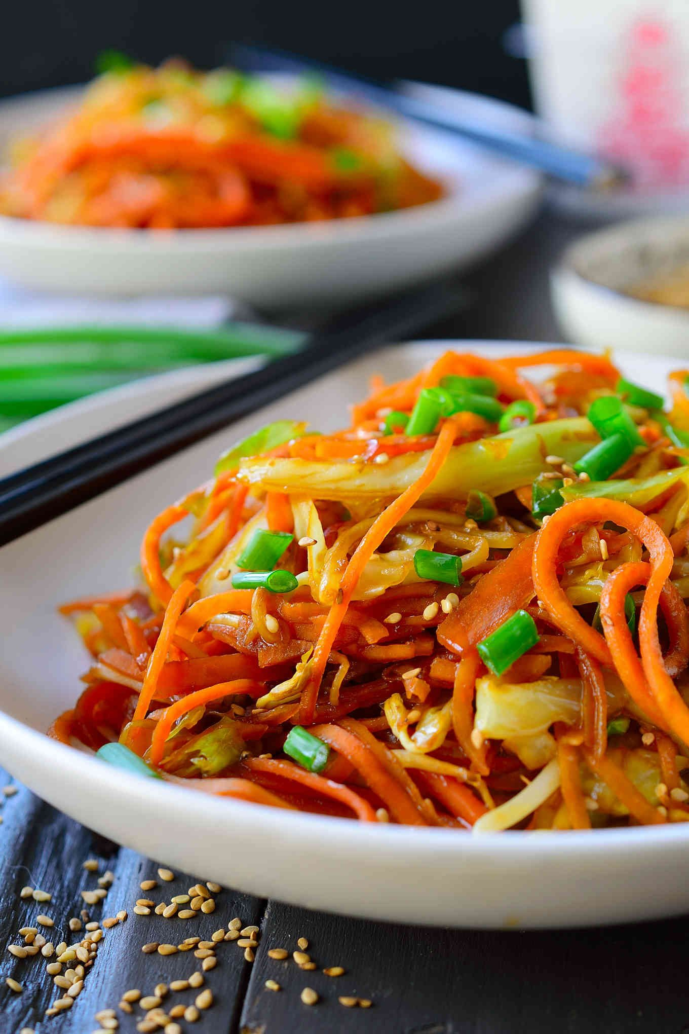 Chow mein sweet potato noodles is a healthy, super quick 15-minute meal that's great for a weeknight dinner. Spiralized sweet potatoes are lightly stir-fried until crisp-tender then tossed with stir-fried cabbage and carrots and a soy sauce-sesame dressing. These noodles are so addictive that you'll want to have them every night!