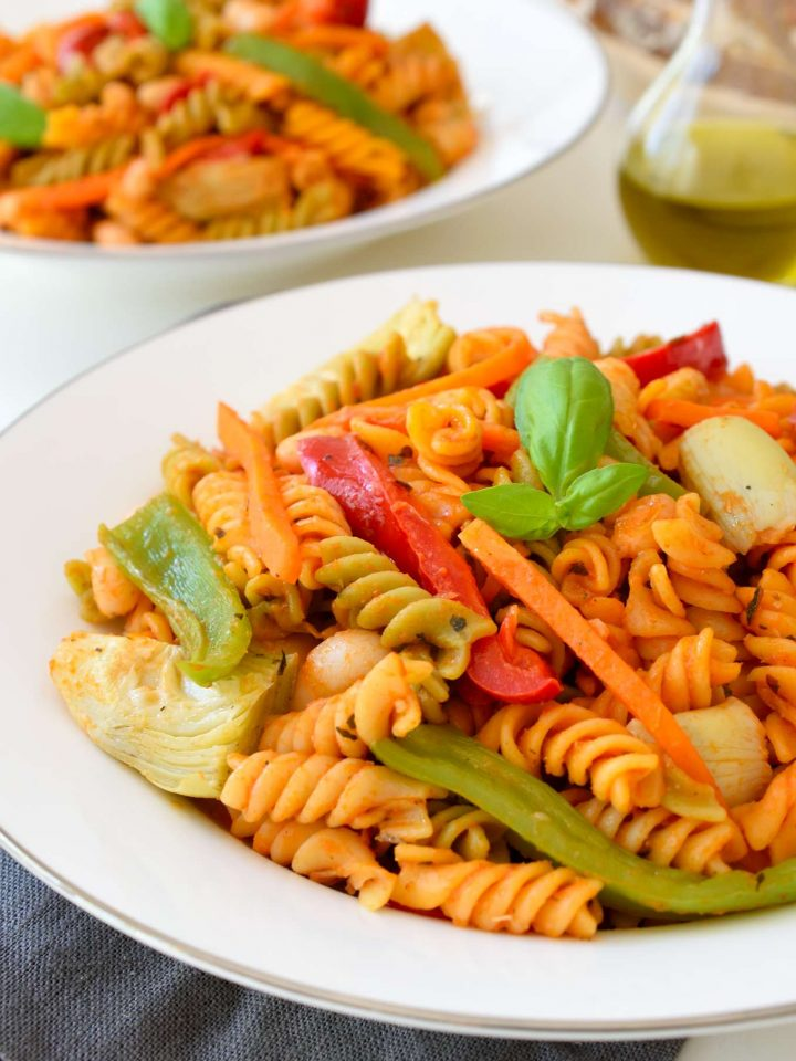This vegetarian Sicilian pasta recipe is easy to make and full of the flavours of the Mediterranean. Sweet bell pepper, crisp carrots, artichoke hearts and white beans in a simple tomato sauce make a hearty and satisfying 15-minute meal.