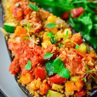 An easy to prepare vegan stuffed eggplant with a rainbow of veggies, crispy breadcrumbs and homemade tomato sauce.