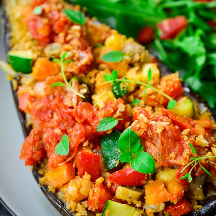 An easy to prepare vegan stuffed eggplant with a rainbow of veggies, crispy breadcrumbs and homemade tomato sauce.