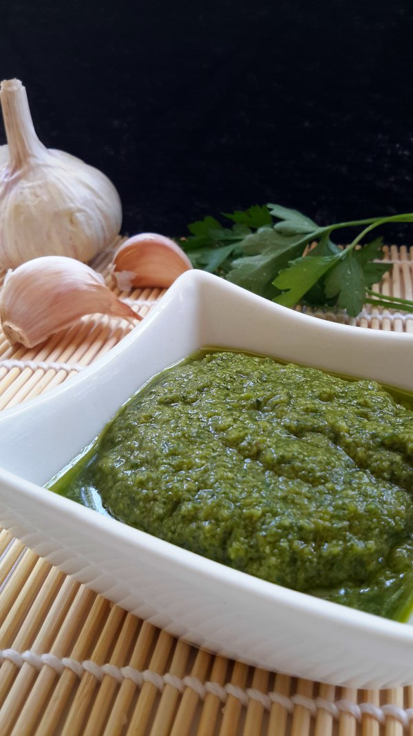 A simple and easy to prepare vegan pesto. Miso paste is used in place of parmesan. Use basil or a mix of fresh herbs, pine nuts or walnuts, garlic, and extra-virgin olive oil.