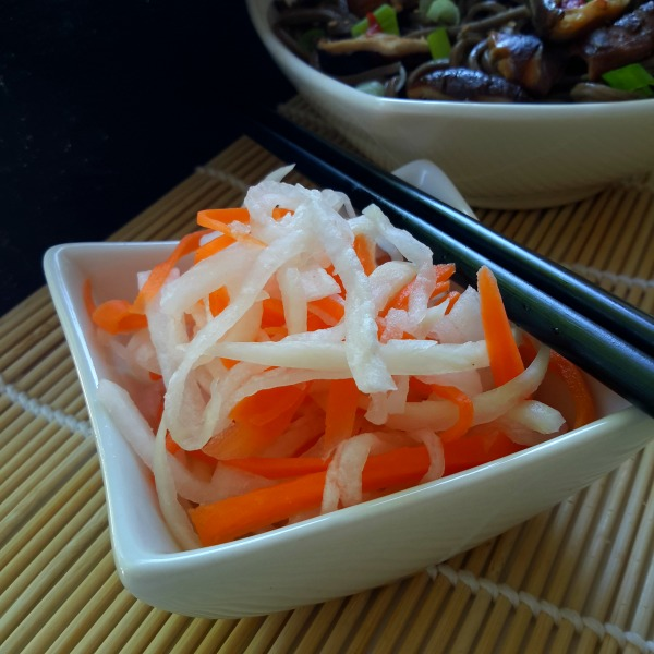 A refreshing daikon radish and carrot salad lightly picked in a sweet vinegar dressing. Simple to prepare and refreshing as a side dish on a hot summer's day.