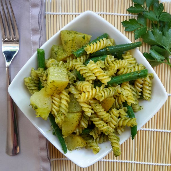 A simple and refreshing pasta dish prepared with vegan-friendly pesto.