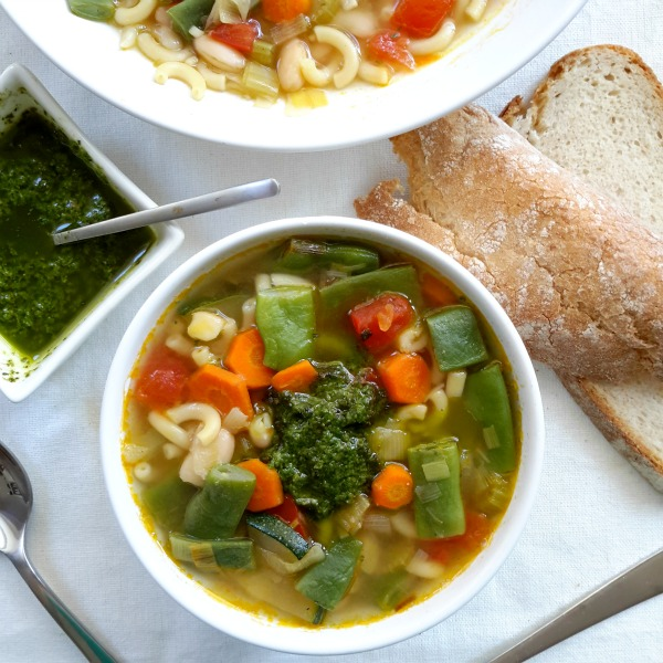 Soupe au pistou, a fresh vegetable soup from Provence. The secret is the pistou, a pesto-like sauce stirred into the soup just before serving. Great for using up the last of your summer vegetables.