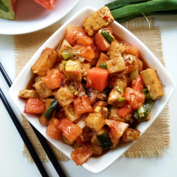 Spicy kung pao tofu with sweet, fresh watermelon. Sounds strange but it works! A savory and refreshing recipe with easy to follow instructions.
