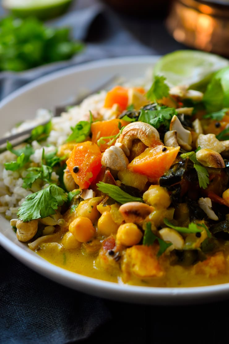 Vegan pumpkin curry with chickpeas and kale. A hearty and delicious vegetarian meal all year round!