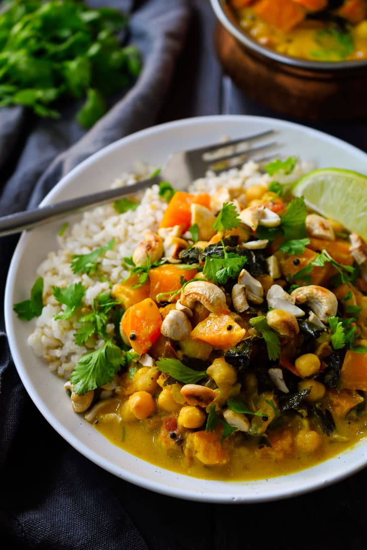 This vegan pumpkin curry is creamy and delicious with chickpeas, kale and a spiced coconut milk base.