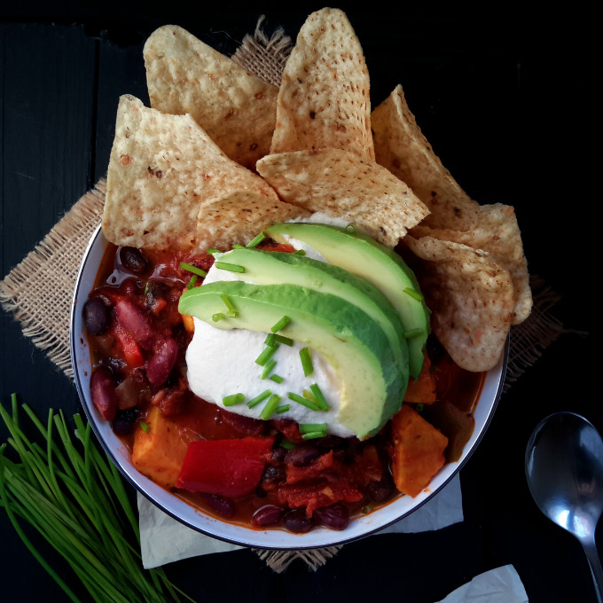 Vegan chili, anyone? With sweet potatoes, black beans and vegan sour cream. What else?