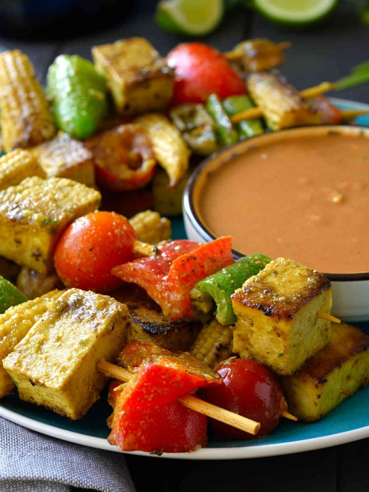 This vegan satay with peanut sauce is easy to prepare and great served as party finger food. Mixed vegetables and tofu are marinated in a delicious Thai-style coconut milk marinade then fried until soft and crispy on the outside. Served with a tasty peanut and lime sauce on the side for dipping.