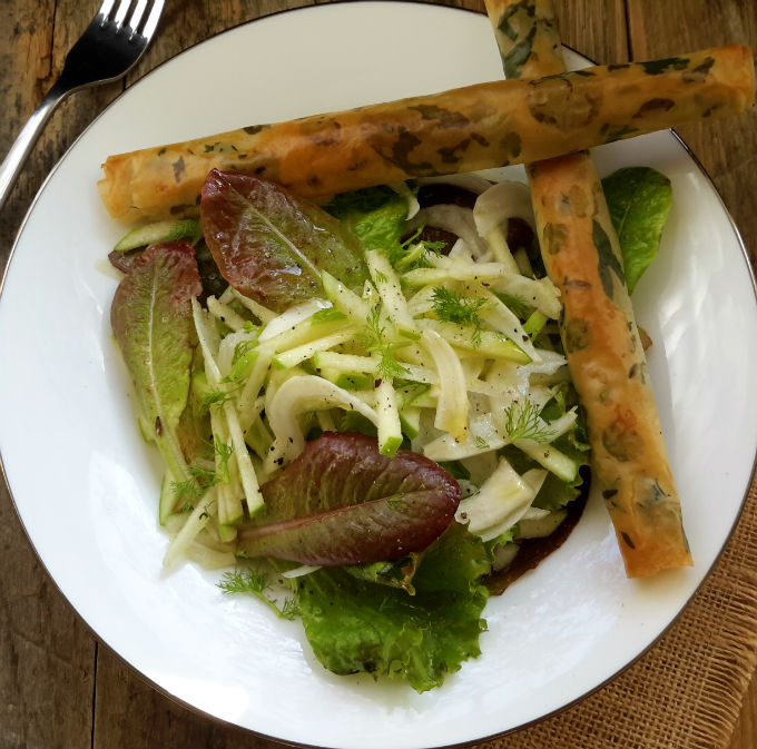 Delicious winter flavours of fennel and green apple combine in this salad with crisp, refreshing lettuce. Phyllo cigars filled with olive tapenade and decorated with fresh herbs make a simple yet elegant starter.