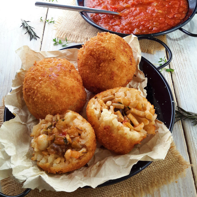 They may look fancy but arancini are actually super easy to make. A basic risotto and a savory mushroom filling rolled into balls and fried with a crispy breadcrumb coating. Totally vegan/vegetarian but everyone will enjoy them!