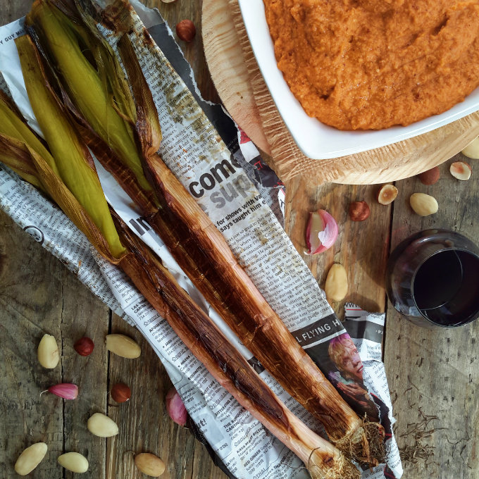 The Spanish tradition of roasted calçots is possible to do at home even if you don't have calçots. Leeks make a great substitute and the romesco sauce is to die for.