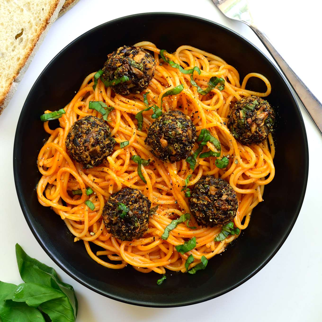 Spaghetti with quinoa meatballs is a hearty, satisfying dish. These vegan meatballs are super easy to make and are baked to make them light and healthy.
