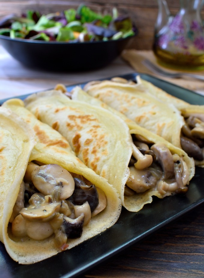 These creamy mushroom crepes are so good you would never guess that they're vegan! A mix of mushrooms simmered in a vegan cream sauce and flavoured with romemary. Simple and delicious.