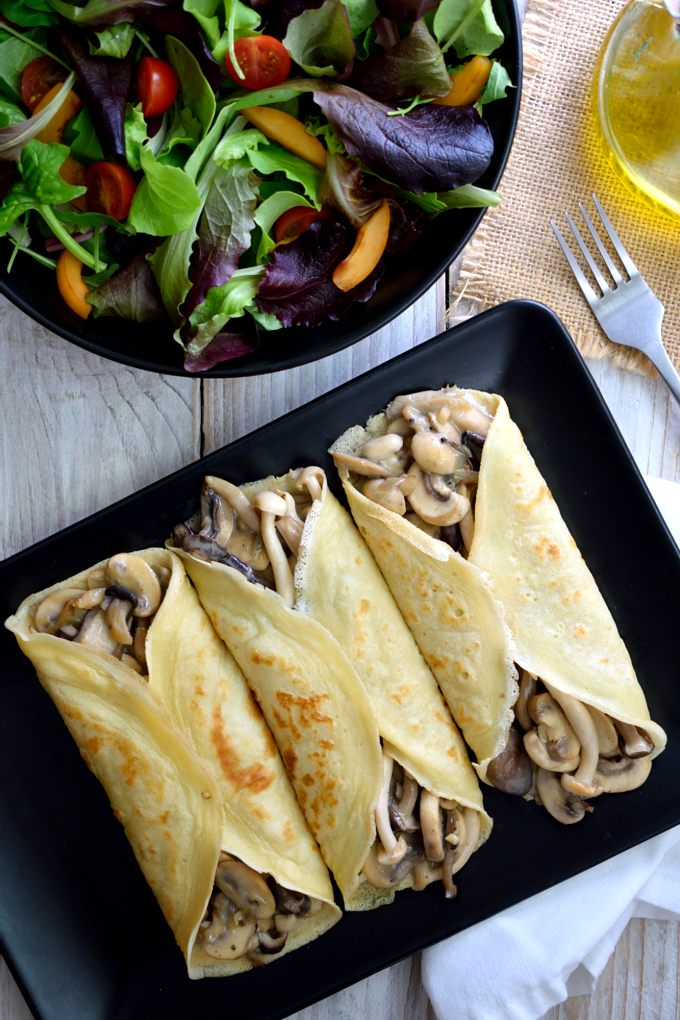 These creamy mushroom crepes are so good you would never guess that they're vegan! A mix of mushrooms simmered in a vegan cream sauce and flavoured with rosemary. Simple and delicious.