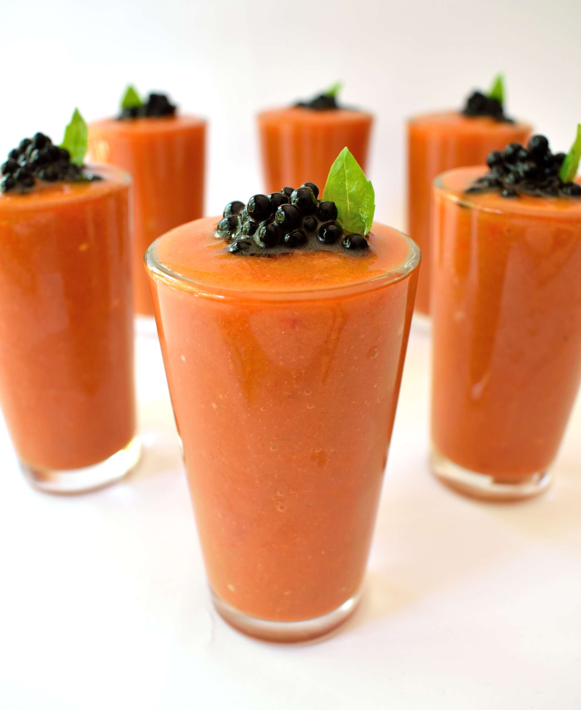 Fresh summertime gazpacho with balsamic caviar. Balsamic caviar is really easy to make and looks cool on any dish. Serve these individual portions at your next party and impress your guests!