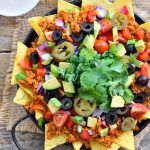 "Delicious, loaded veggie nachos with TVP taco ""meat"". There's so much going on with these nachos that nobody will realize that they're totally plant-based and vegan."