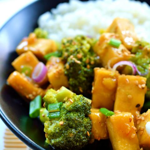 Orange and ginger glazed tofu is a quick and easy 30-minute weeknight meal. Crispy pan-fried tofu and fresh, crisp steamed broccoli in a sweet, ginger orange sauce. A healthy vegan/vegetarian meal.