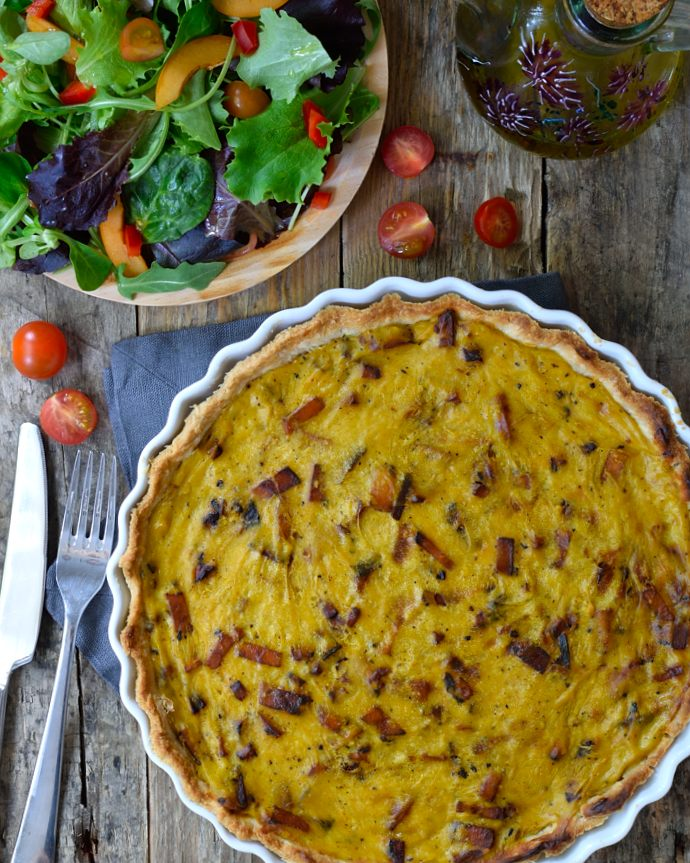 This vegan quiche lorraine is made from a base of chickpea flour. Smoky tofu bacon is the perfect filling. Makes a great dish for Sunday brunch, lunch or dinner!