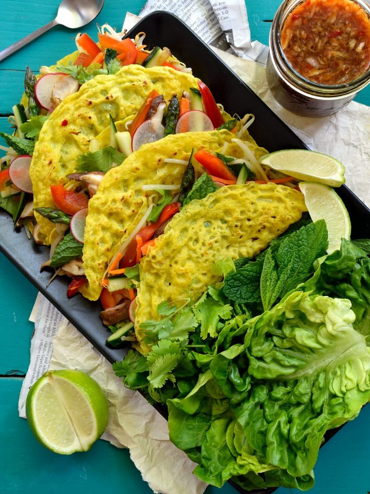These vegan banh xeo (Vietnamese crepes) are so simple and delicious. Crispy crepes with a sweet hint of coconut stuffed with fresh veggies and wrapped in herbs and lettuce. A great vegan or vegetarian meal!