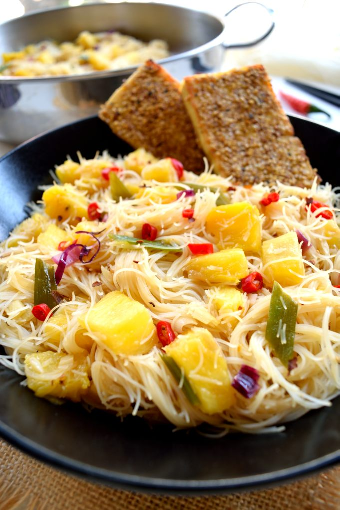 These pineapple vermicelli rice noodles are a sweet, savory, (slightly) spicy way to get your pineapple fix this summer. They're delicious served along with sesame-crusted tofu for a delightful nuttiness and a healthy dose of protein. A delicious vegan and vegetarian main dish!