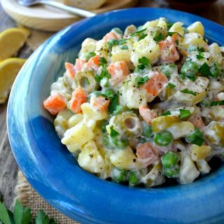 Here's a recipe for another uber-typical Spanish tapa: ensaladilla rusa or vegan Russian salad. It's a very easy potato salad that will most definitely find in any and all bars serving tapas in Barcelona. However, you'd be hard-pressed to find a vegan version of ensaladilla rusa, as it usually contains tuna and always mayonnaise. Luckily, the tuna is not essential and the mayonnaise is easy to veganize so here's my version of vegan ensaladilla rusa.