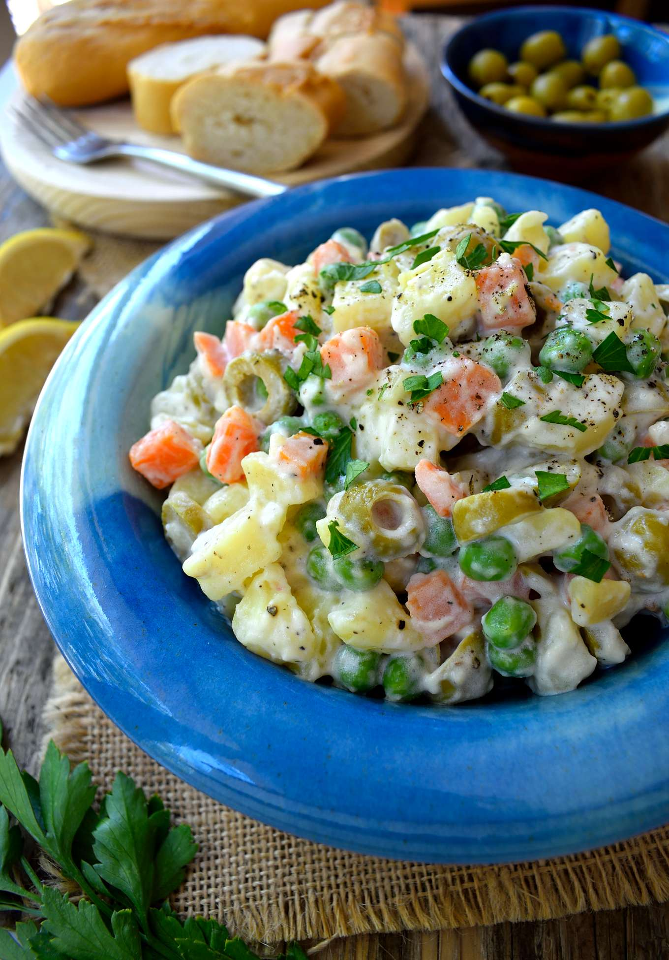Here's a recipe for another uber-typical Spanish tapa: ensaladilla rusa or vegan Russian salad. It's a very easy Spanish potato salad that will most definitely find in any and all bars serving tapas in Barcelona. However, you'd be hard-pressed to find a vegan version of ensaladilla rusa, as it usually contains tuna and always mayonnaise. Luckily, the tuna is not essential and the mayonnaise is easy to veganize so here's my version of vegan ensaladilla rusa.