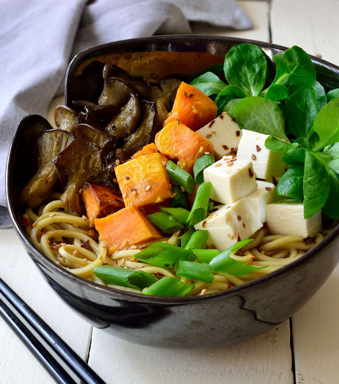 Fresh vegetables, silky soft tofu and homemade broth will give you a healthy, satisfying and oh-so-tasty ramen experience. This mushroom ramen recipe is replete with the flavours of autumn: fresh mushrooms, sweet potato and leafy greens.