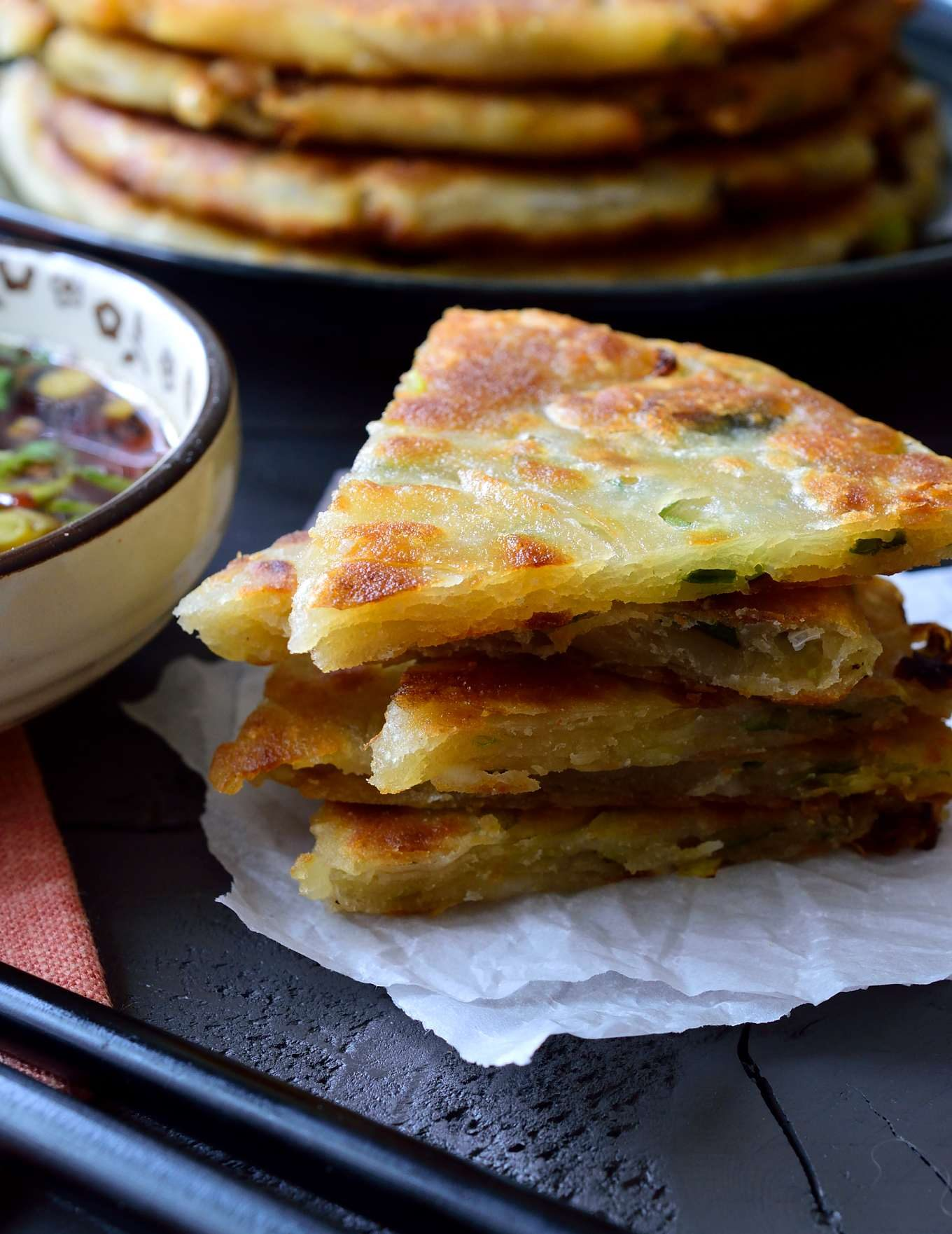 Vegan scallion pancakes are easy, tasty and make a great vegan or vegetarian appetizer or side. The technique may look tricky, but it's actually very easy!