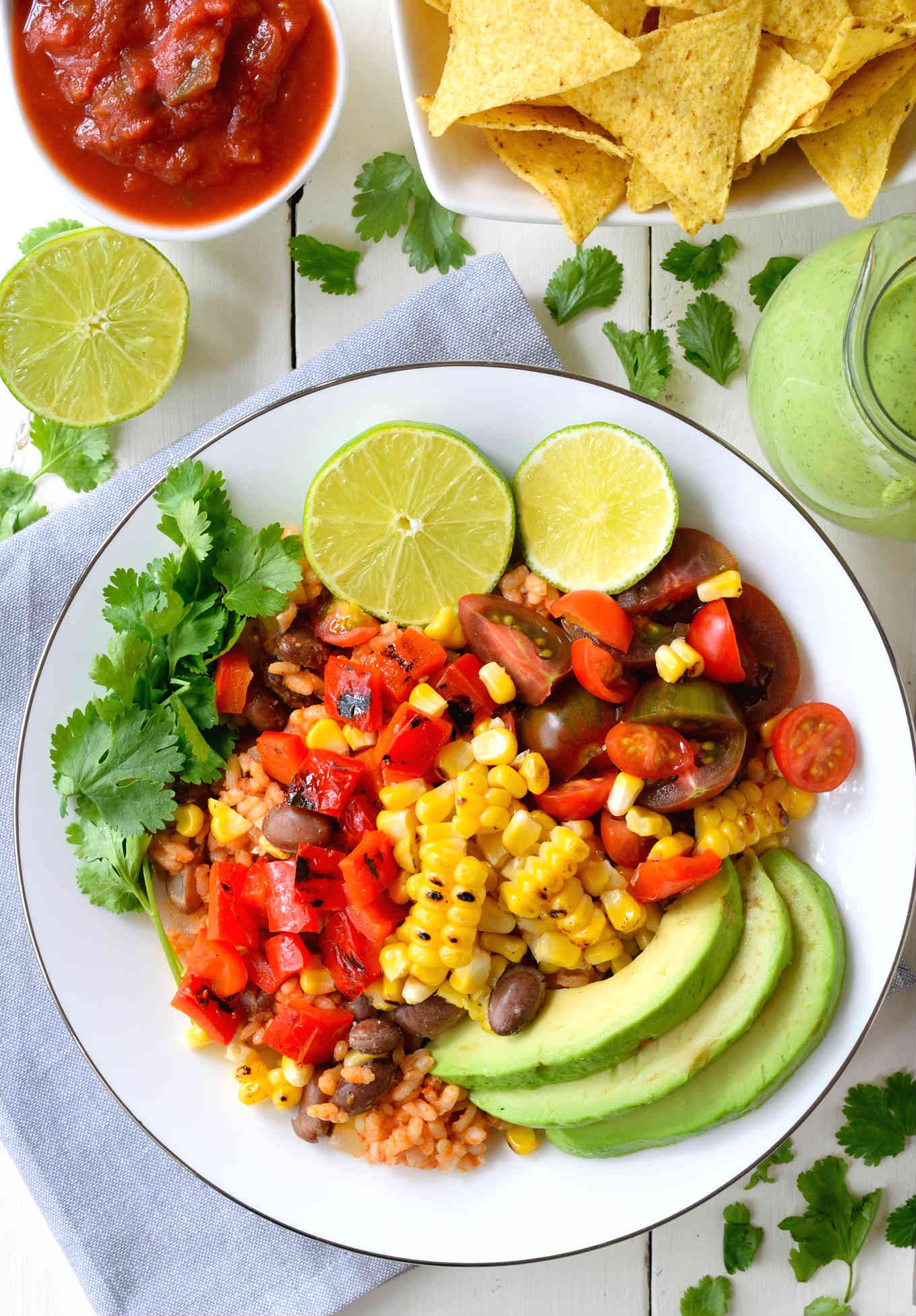 This grilled veggie vegan burrito bowl is packed with flavour and so much healthier than takeout. You will definitely be eating the rainbow when you get this bowl on the table and the mix of hearty rice and beans with fresh tomatoes, creamy avocado and grilled corn and peppers will fill you up for the rest of the day.