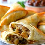 This vegan samosa recipe is a quick and easy version of traditional potato samosas with mango chutney. Save time and lighten up your samosas by wrapping them with phyllo dough and baking instead of frying. You get all the flavours of a samosa but without the grease and in half the time!
