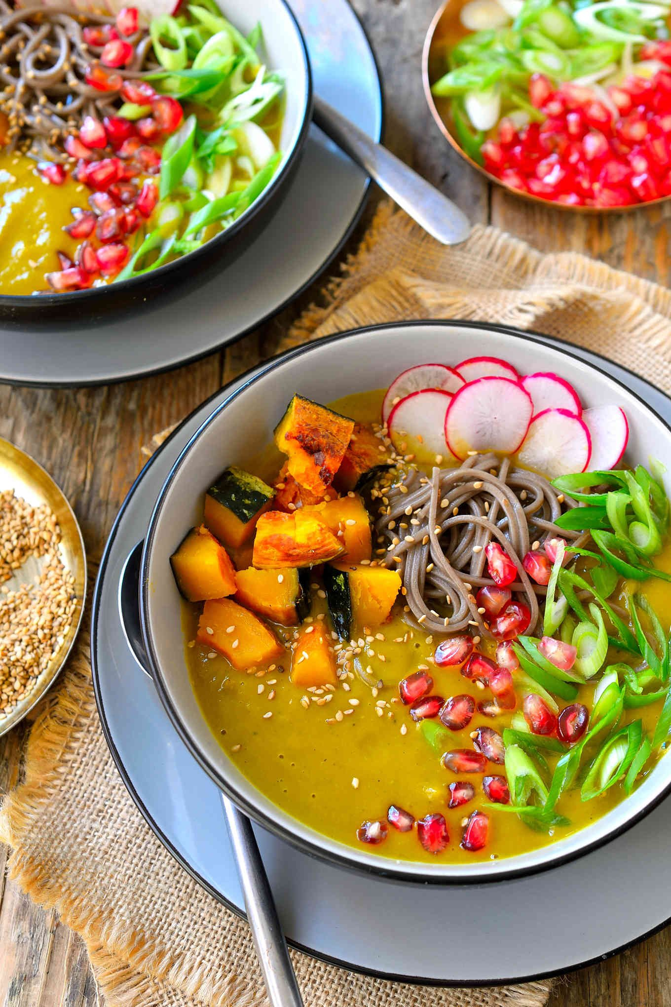 This roasted kabocha squash soup with soba is a whole meal in a bowl. Sweet winter kabocha squash with nutty soba noodles, crunchy pomegranate seeds and spicy radish slices combine in a warm, comforting soup that is perfect for a chilly fall or winter evening.