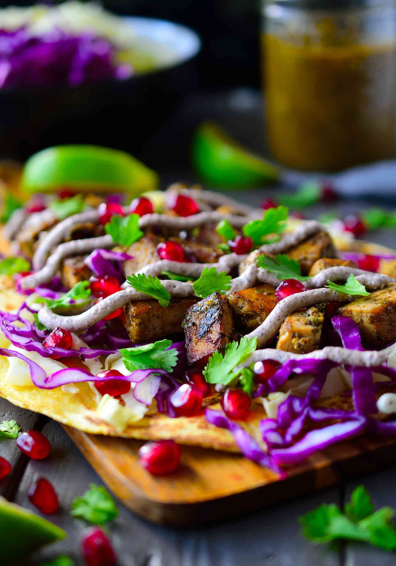 These colourful Jamaican jerk tofu tacos are easy, delicious and bursting with a complex mix of flavours and textures. Simply marinate some tofu in an easy blender wet Jamaican jerk seasoning, fry them up and add your favorite toppings. These vegan tacos are so delicious you won't be able to get enough!