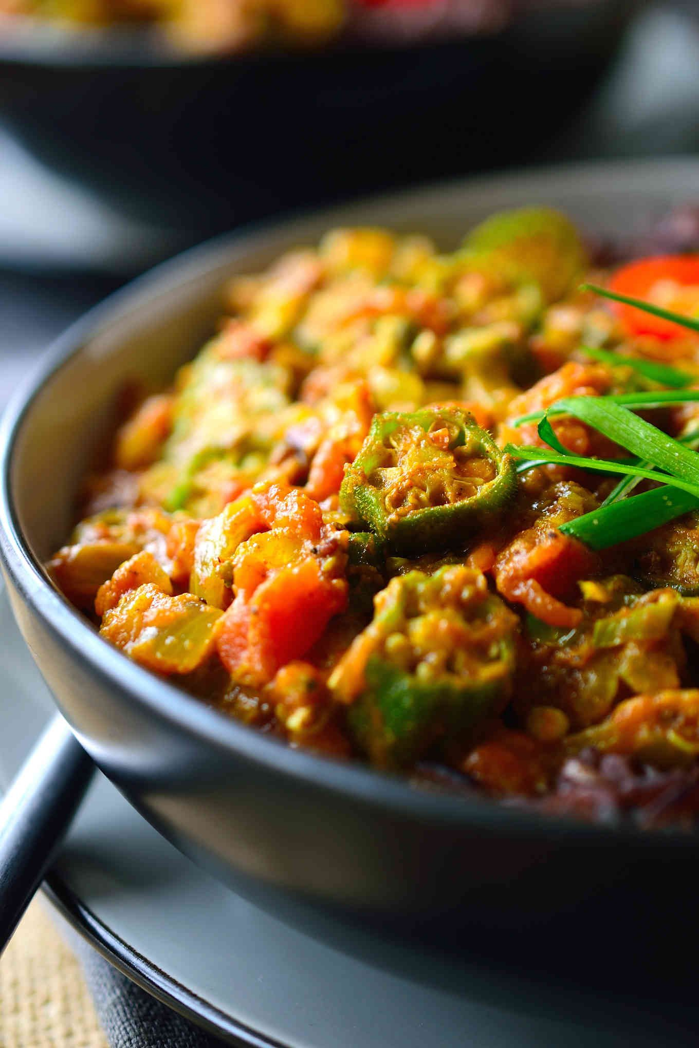 This curried okra recipe, or bhindi masala, is a simple semi-dry curry featuring fried okra in a fragrantly-spiced tomato-based sauce. You'll need just a few ingredients, a selection of Indian spices and about 20 minutes to get this vegan okra curry on the table.