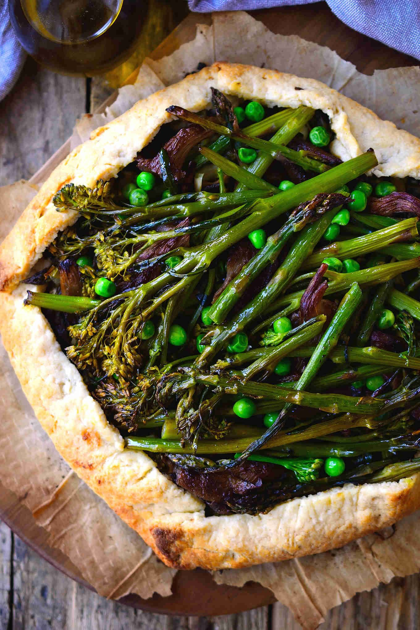 This vegan galette encompasses all the flavours of spring with fresh asparagus, broccolini and garden peas on a bed of kale and vegan ricotta cheese. Sautéed oyster mushrooms add a smoky, meaty element and the vegan pie crust is light and deliciously flaky. Serve this spring vegetable vegan galette as part of an Easter meal, mother's day brunch, take it to a picnic or for just a regular Tuesday night dinner to welcome spring's wonderful produce!