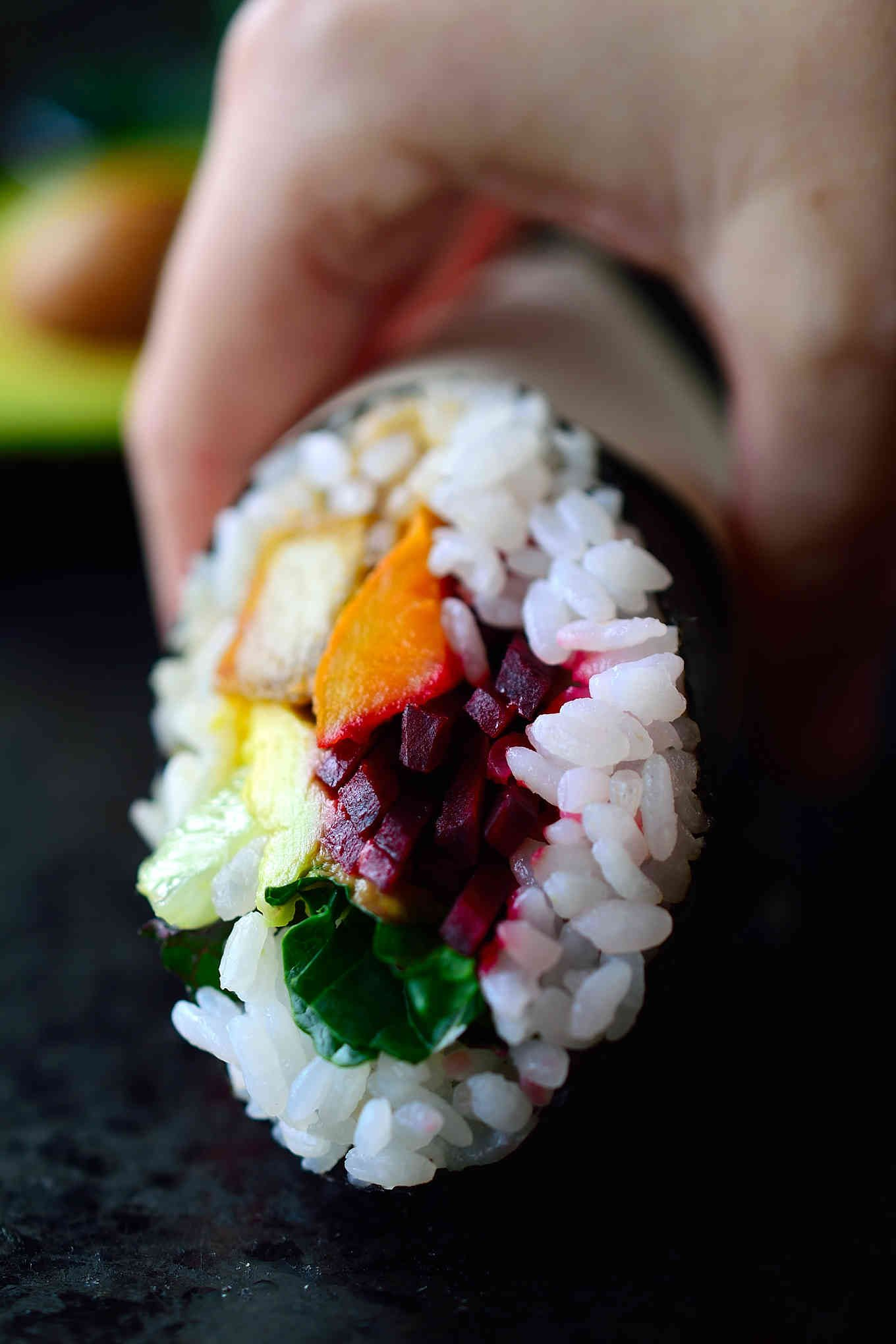 This vegan sushi burrito recipe is the marriage between two great foods in one perfect hand-held package. They're easy to make, packed with flavour and super adaptable to whatever fillings you choose. I've stuffed sushi burritos with a rainbow of vegetables and deliciously crispy fried teriyaki tofu.