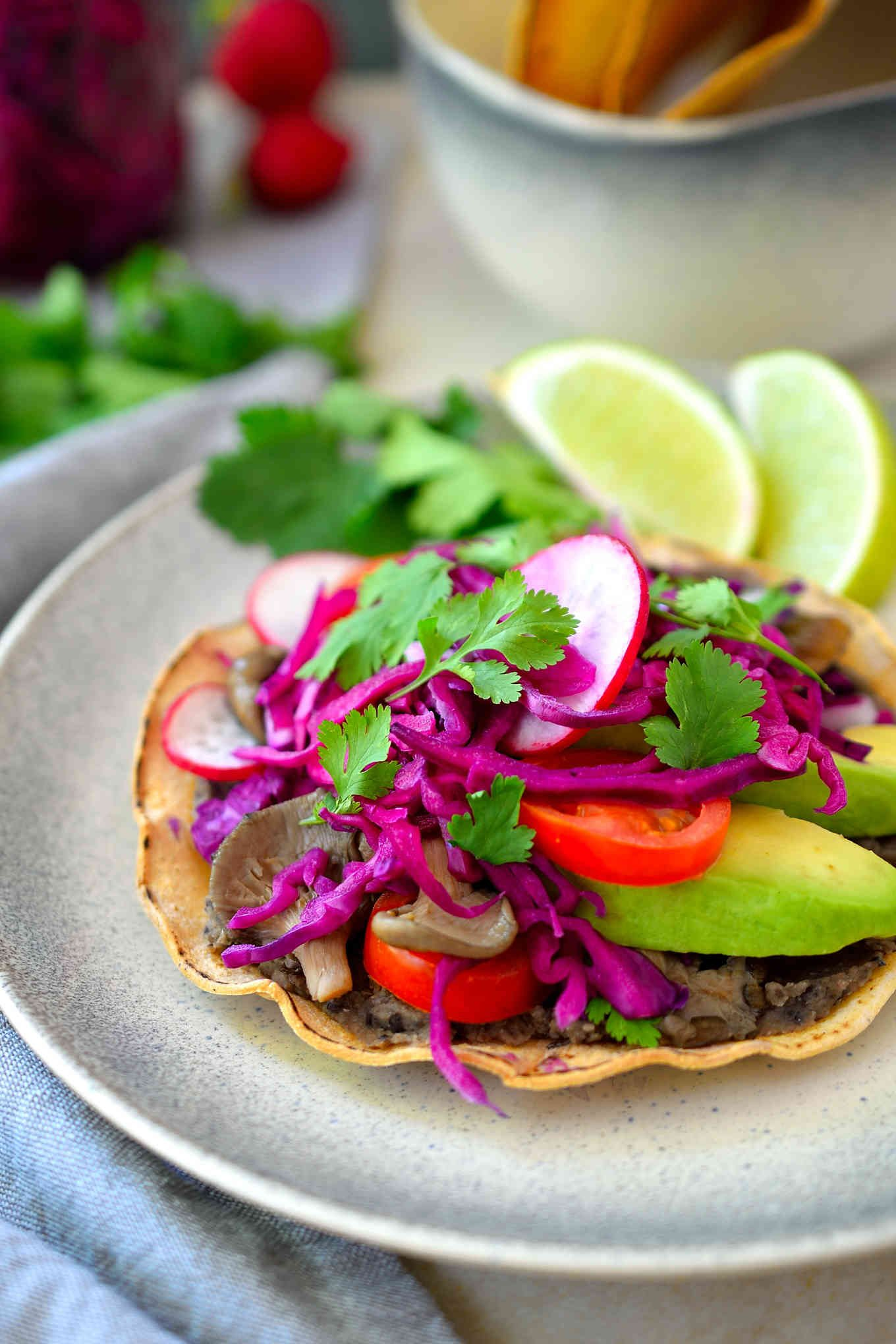These black bean and mushroom vegan tostadas are easy to put together and totally adaptable to whatever veggies you happen to have on hand.