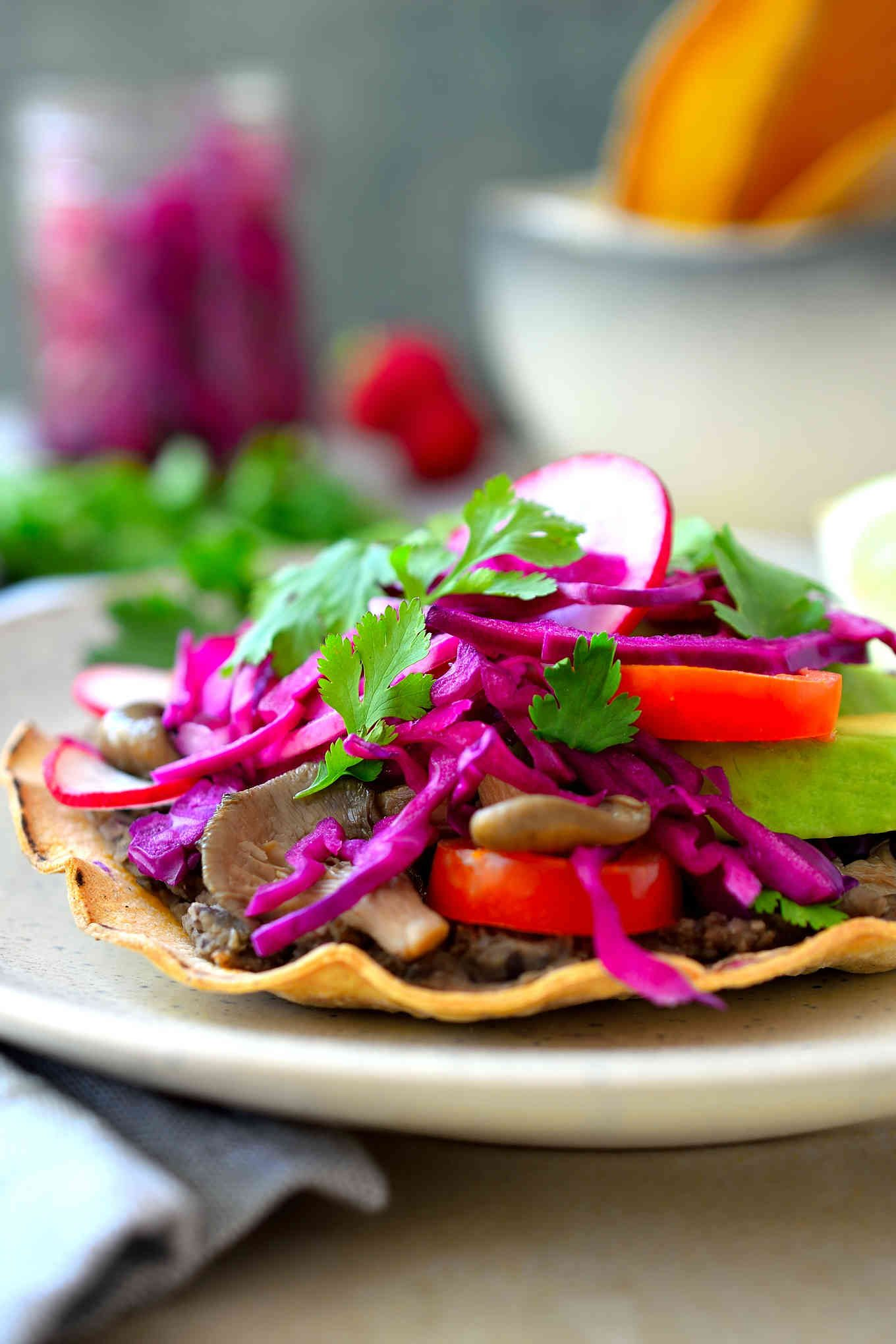 Black bean and mushroom vegan tostadas are baked rather than fried for a super healthy, hearty appetizer or entree!