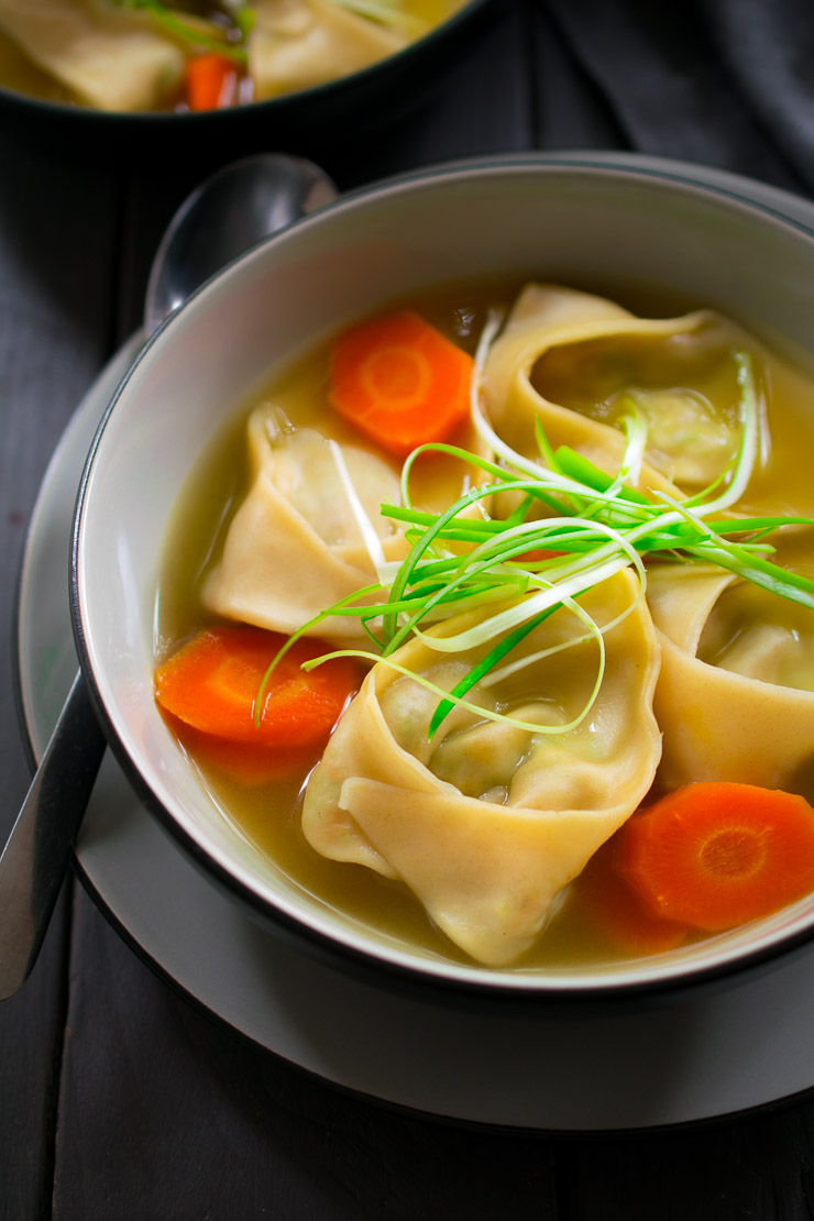 This vegan wonton soup is a steaming and comforting bowl of deliciousness. The vegan wontons are stuffed with an unusual but tasty combination of edamame, carrot and mint, and are floating in a simple vegetable broth to let all those yummy flavours shine through