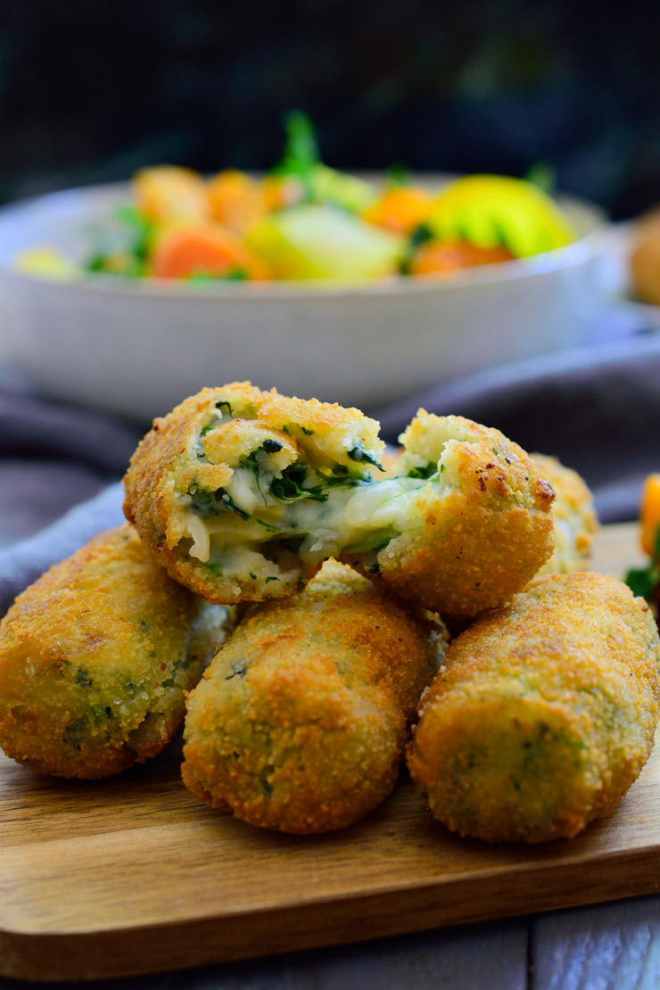 These Spanish spinach croquettes are a typical tapa in bars all around Spain. They're simple to make, packed with flavour and make a great vegan party finger food or appetizer!