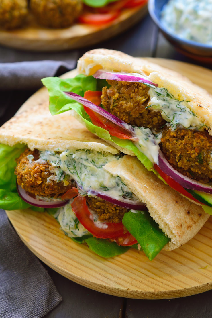 An easy vegan falafel recipe served in pita bread with veggies and vegan tzatziki sauce.