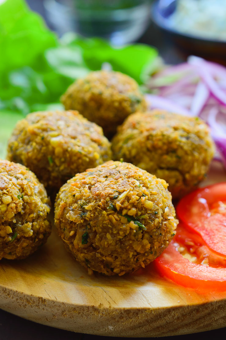 This easy vegan falafel recipe is the most delicious falafel you'll ever have. Crispy on the outside and fluffy on the inside spiced with the wonderful flavours of cumin and coriander. These falafel are great on top of a big bowl of veggies or stuffed into a pita sandwich with a big dollop of vegan tzatziki on top.