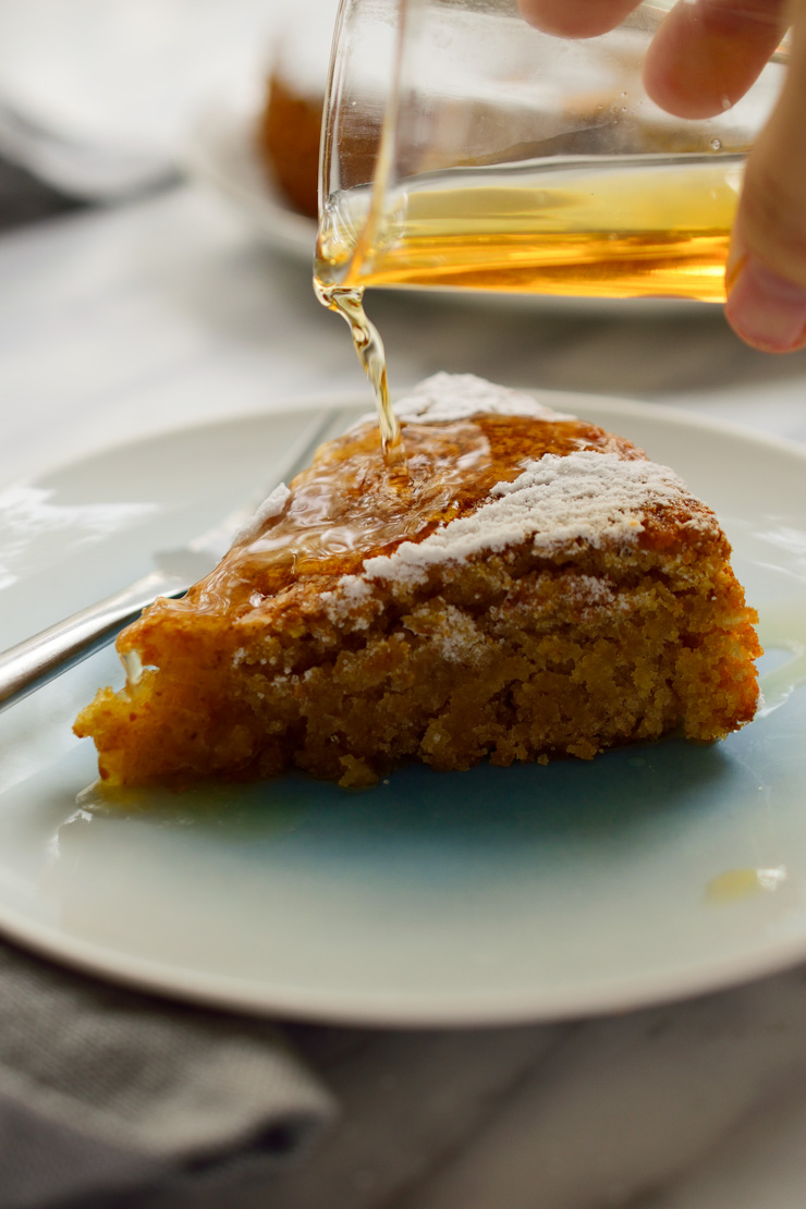 This Spanish almond cake is a vegan version of the traditional Tarta de Santiago from Galicia. This cake is easy to make with minimal ingredients and a clever egg substitute. Decorated with the Cross of Saint James and served with Spanish moscatel (or other sweet liqueur), this vegan Spanish almond cake makes a great dessert to a holiday or a regular weeknight dinner!