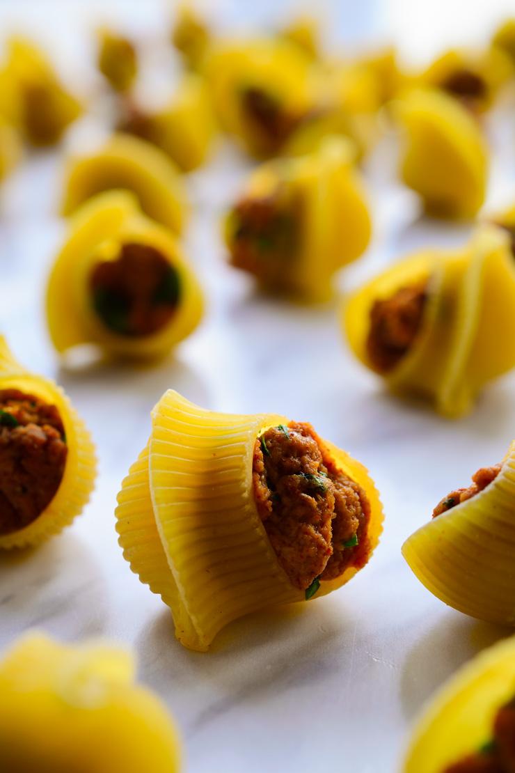 Seitan stuffed pasta shells on a kitchen counter