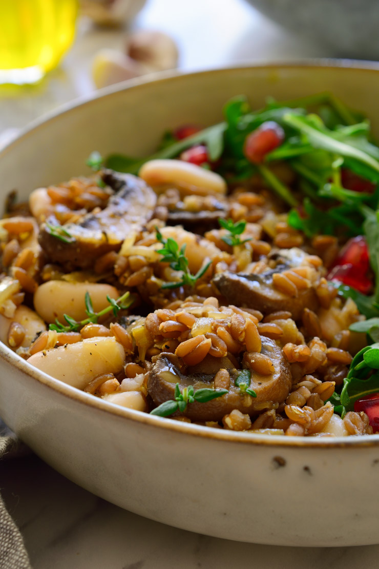 Vegan mushroom farro with beans in a bowl.
