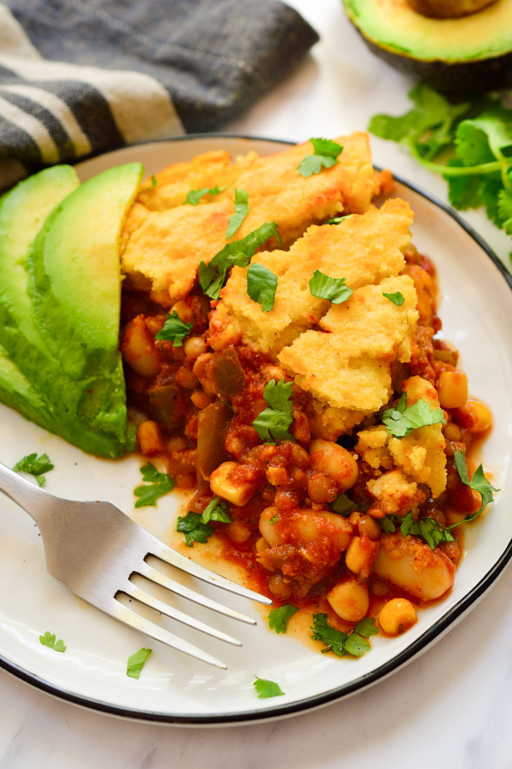 A slice of vegan tamale pie on a plate.