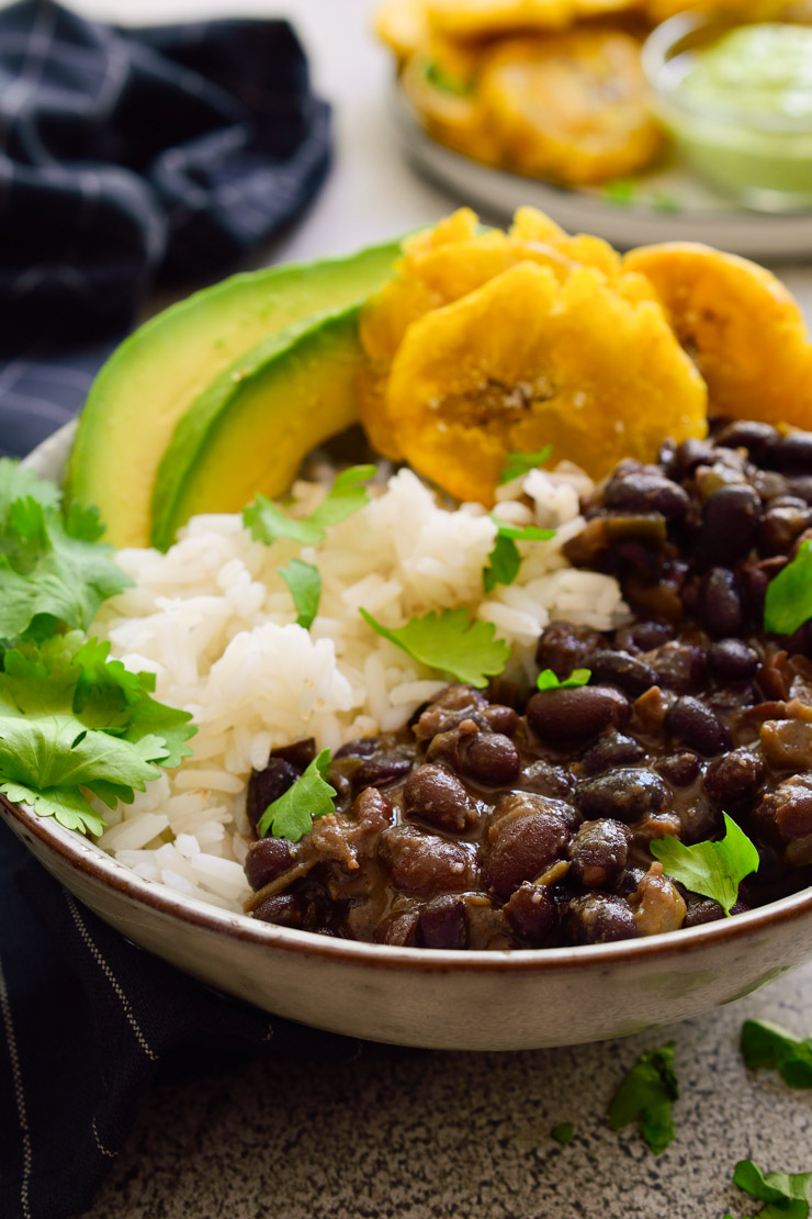 Cuban black beans and rice with tostones, avocado and cilantro.