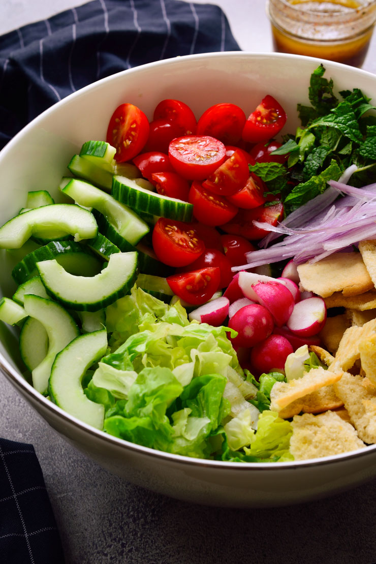 Ingredients for Lebanese salad in a bowl before mixing.