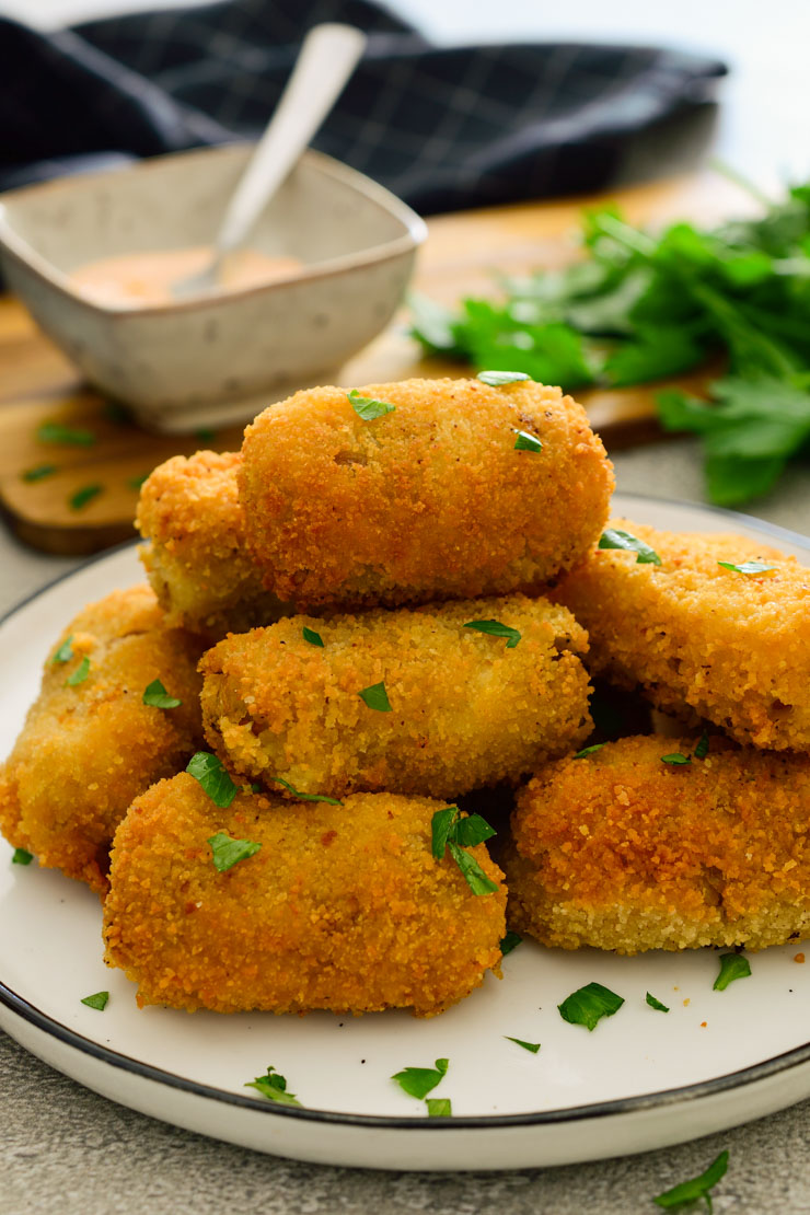 A pile of mushroom croquettes on a plate.