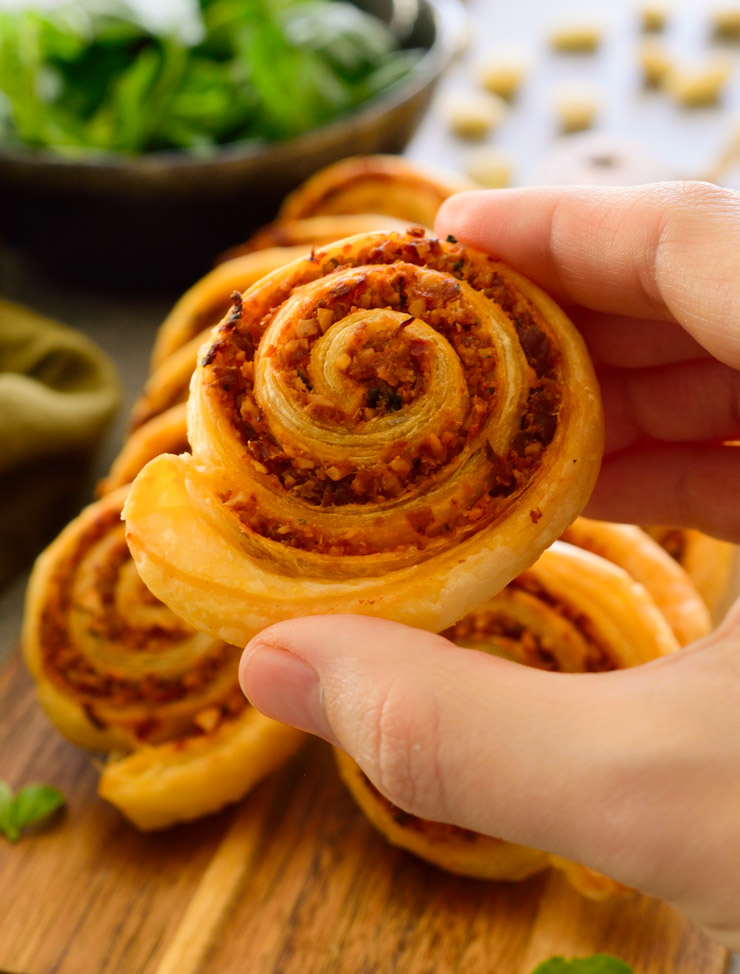 Close-up photo holding a vegan pinwheel.